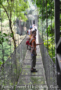 Shelly Rivoli hiking with toddler son at Arenal Hanging Bridges, Costa Rica.
