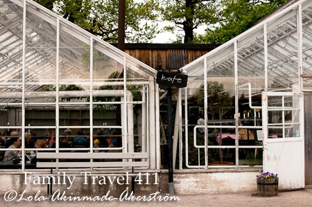 "The kid-friendly ""kafe"" located inside a large glass greenhouse, surrounded by flower and herb gardens and fruit orchards."