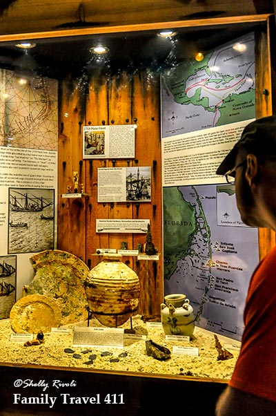 Exhibit showing Spanish galleons history at Key West Shipwreck Museum.