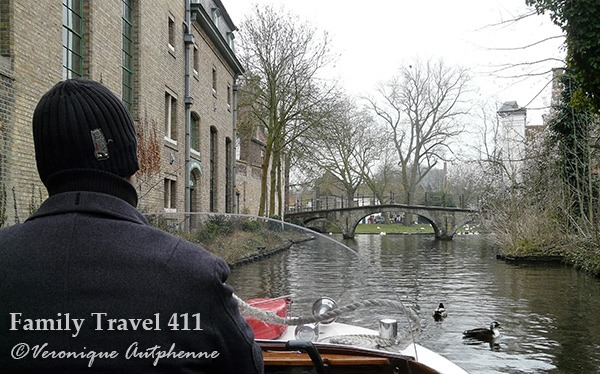 Cruising the canals is the perfect way to explore Bruges with kids.
