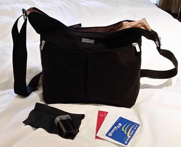 The Baggallini Cargo Bagg is the best travel purse for toting a DSLR I've found.