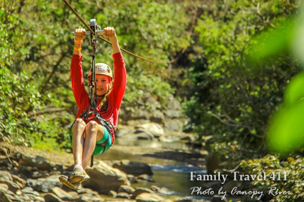 12-year-old ziplining through the bottom of the canyon.