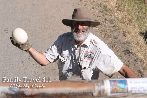 Tour guide presents ostrich egg on jeep tour at Safari West in Santa Rosa
