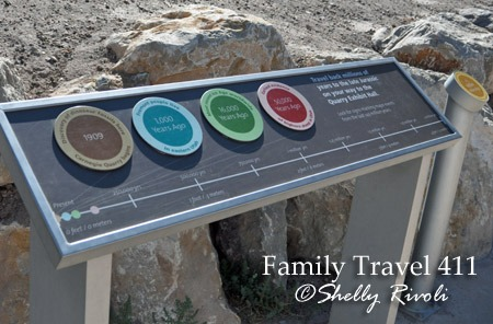 Historical timeline markers at Dinosaur National Monument with kids