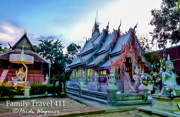 Start your visit to Chiang Mai's night market with a dusk view of the Silver Temple (Wat Sri Suphan).