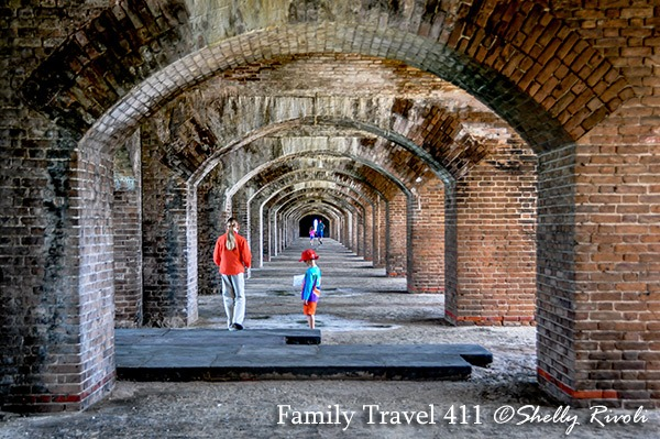 kids inside Fort Jefferson with brick archways