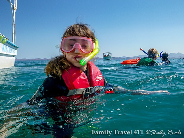 in La Paz with kids preparing to swim with whale shark wearing snorkel