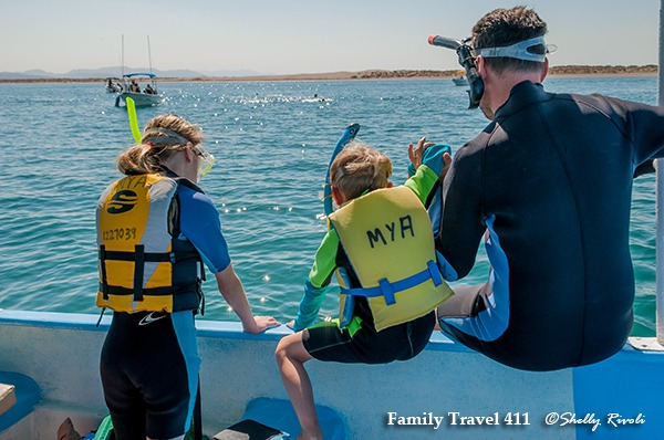 kids get ready to swim with whale shark in la paz bay, Mexico