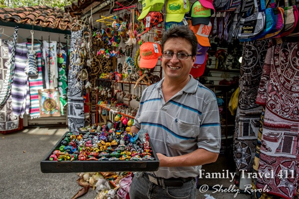 Souvenirs and Mexican handicrafts await in the shady lane along the Rio Cuale.
