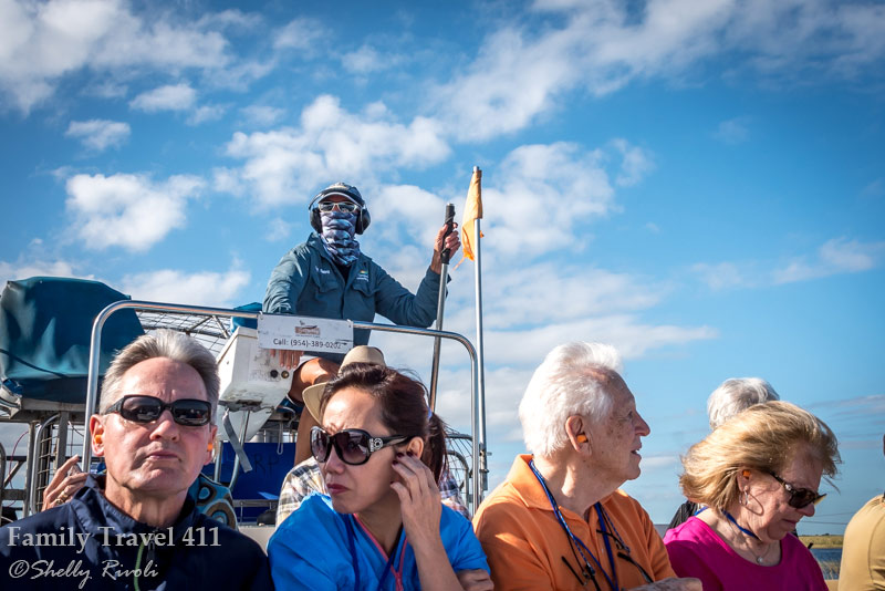 Airboat passengers and captain in the Everglades
