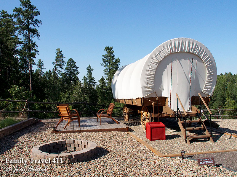 covered wagon used for glamping near Mount Rushmore