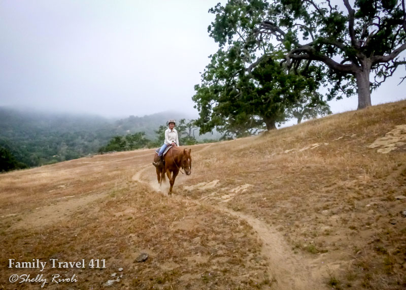girl on horseback in misty California morning hills