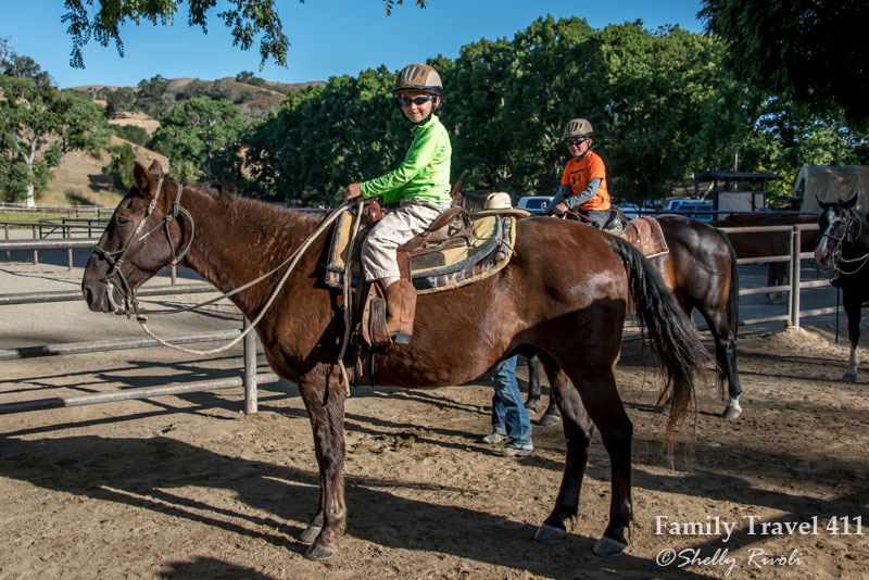little boy ready for morning instructional ride at The Alisal Guest Ranch.