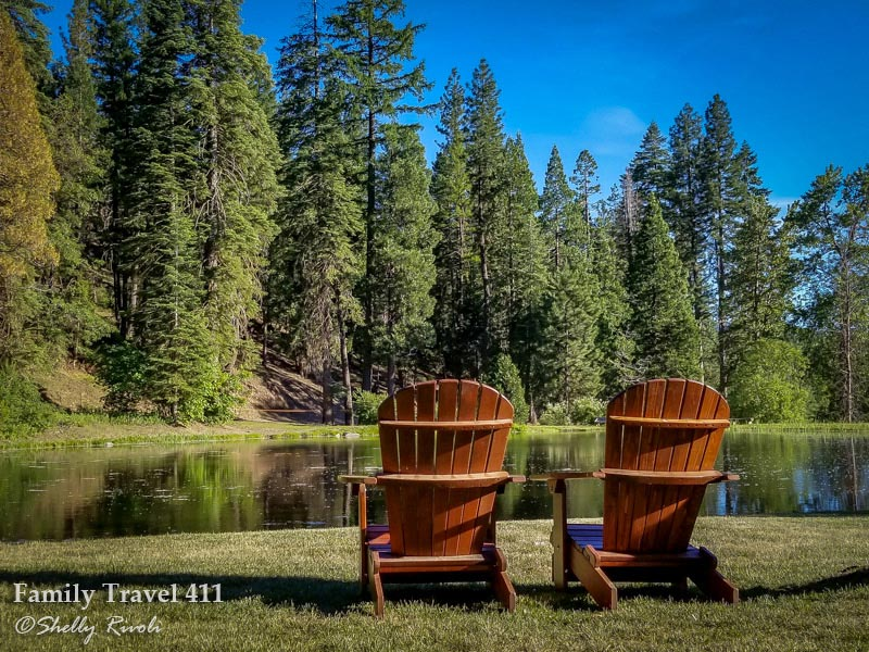 Adirondack chairs beside pond at the Greenhorn Ranch