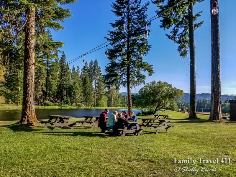 family eating at picnic table during dude ranch vacation